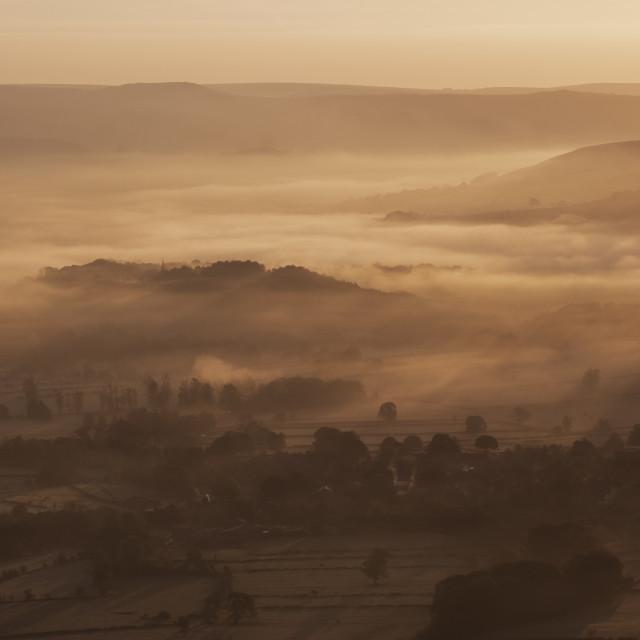 """Misty valley sunrise"" stock image"