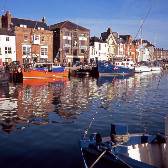 """Weymouth Harbour, Fishing Boat Reflections"" stock image"