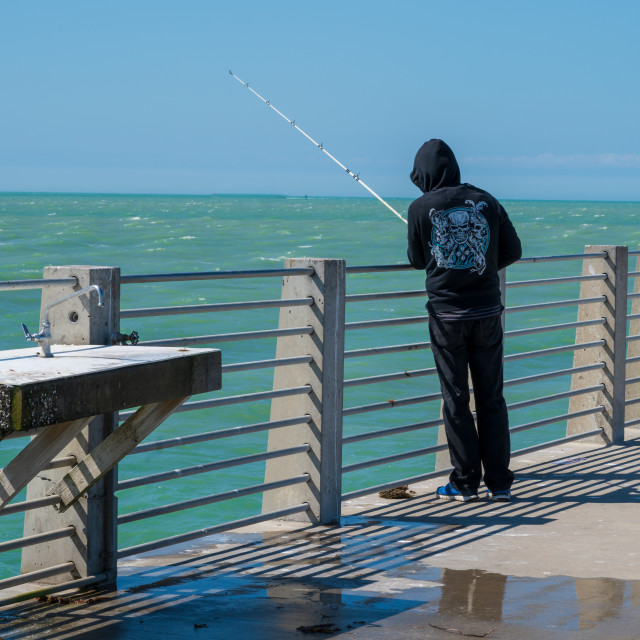 """""""Man Fishing off a Pier"""" stock image"""