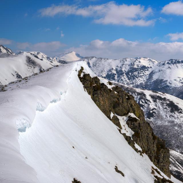 """Snow ridge on the edge of a mountain, in the Sierra de Os Ancares, Galicia"" stock image"