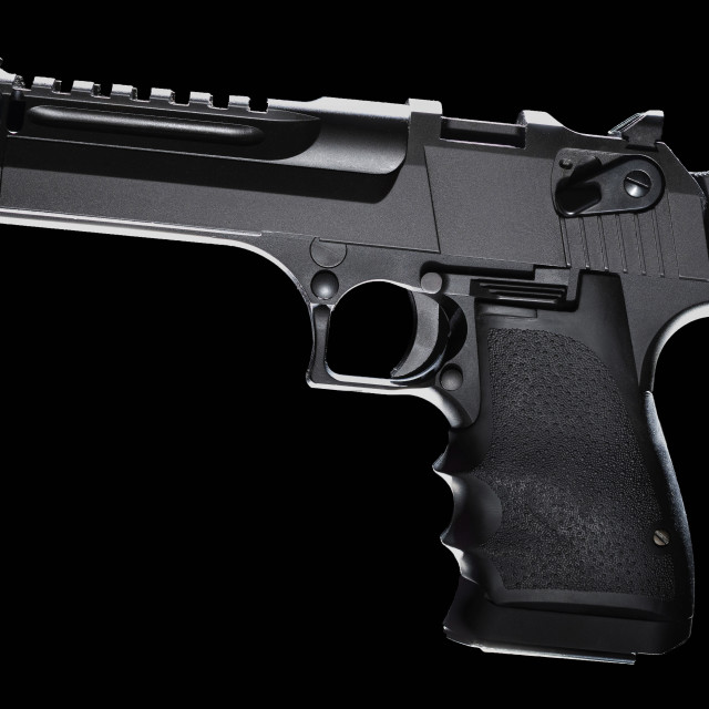 """High-powered semi-auto pistol on black"" stock image"