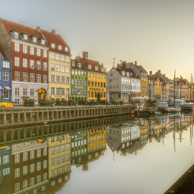 """Morning has broken over the scenic houses on the quay of Nyhavn"" stock image"