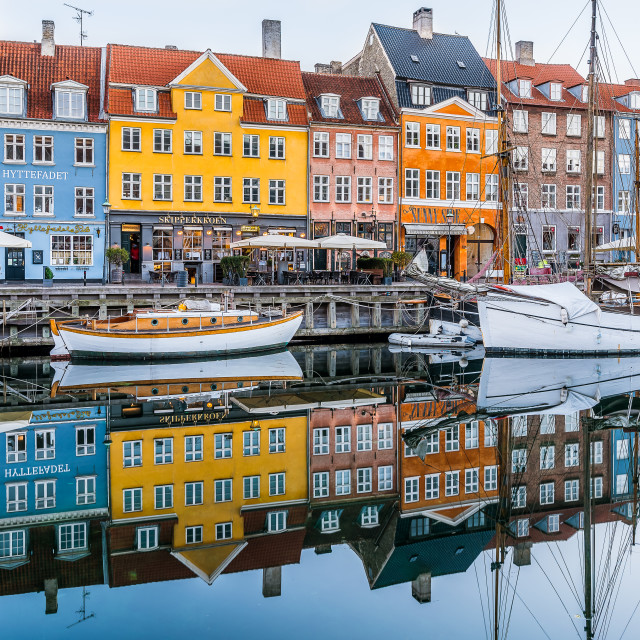 """Reflections of colourful houses in the water of Nyhavn canal in"" stock image"