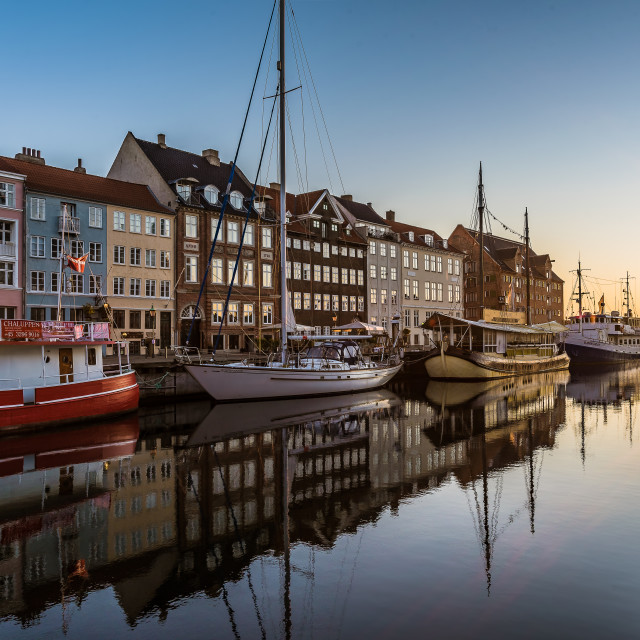 """Colourful houses in the sunrise along the quay at Nyhavn Copenha"" stock image"