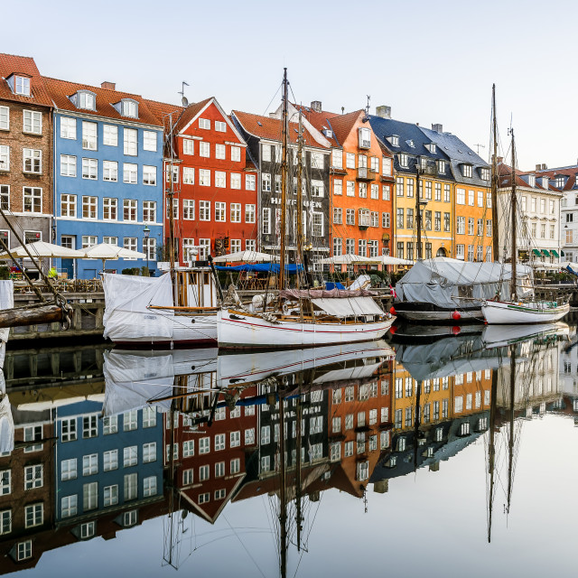 """Sailingboats and colourful houses reflecting in the breathless c"" stock image"