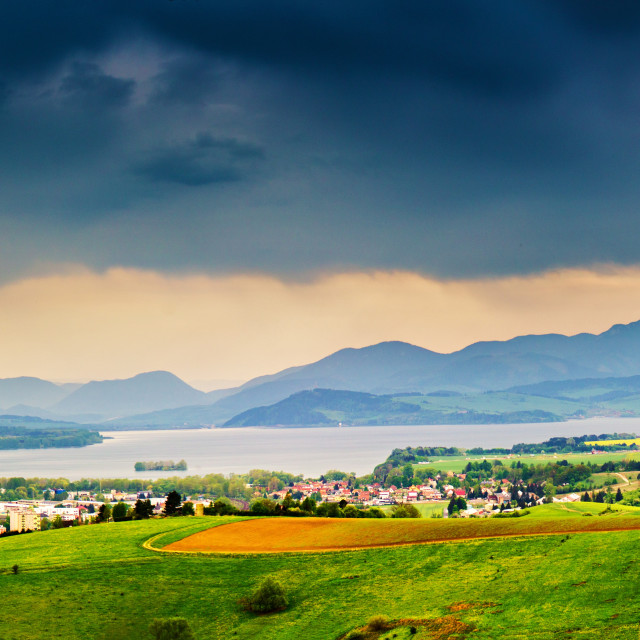 """""""Spring storm in mountains panorama. Overcast dramatic sky"""" stock image"""