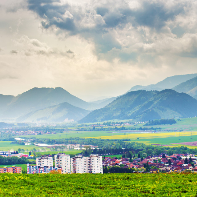 """""""Spring storm in mountains panorama. Liptov town in Slovakia"""" stock image"""