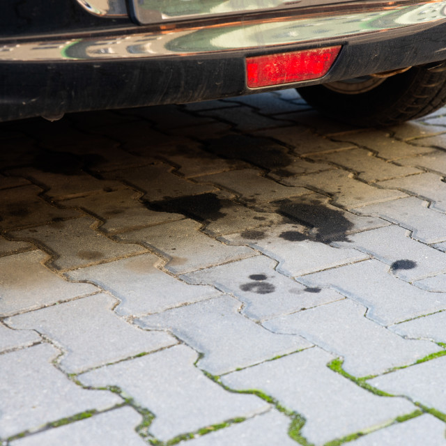 """""""oil leaking from an old car"""" stock image"""