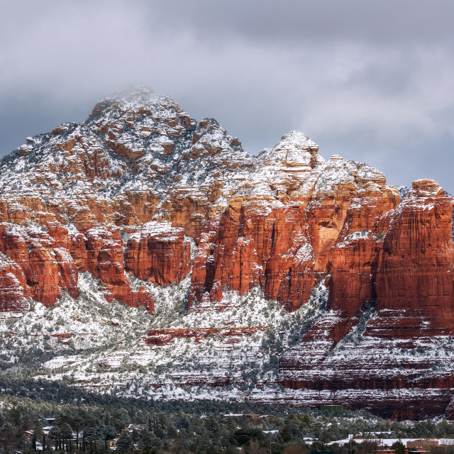 """Snow on Coffee Pot Rock in Sedona, Arizona"" stock image"