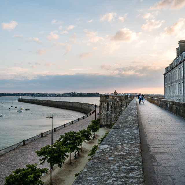 """Promenade on ramparts and cityscape at sunset"" stock image"