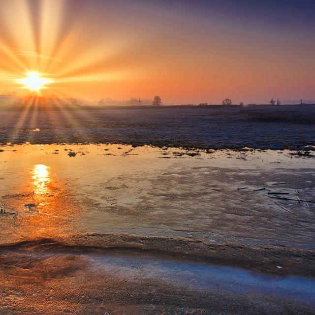 """Dawn over frozen fields"" stock image"