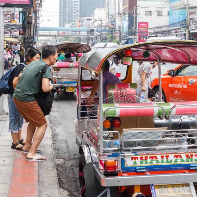 """Tourists negotiating ride"" stock image"