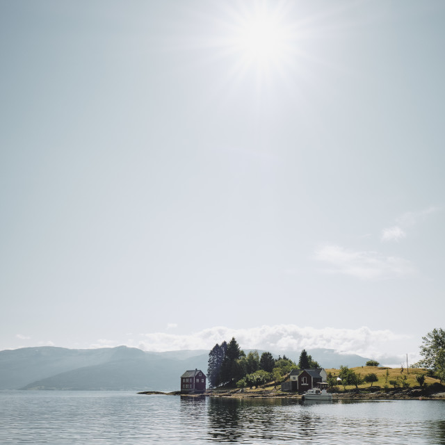 """""""The summer sun over a fjord and island in Norway"""" stock image"""