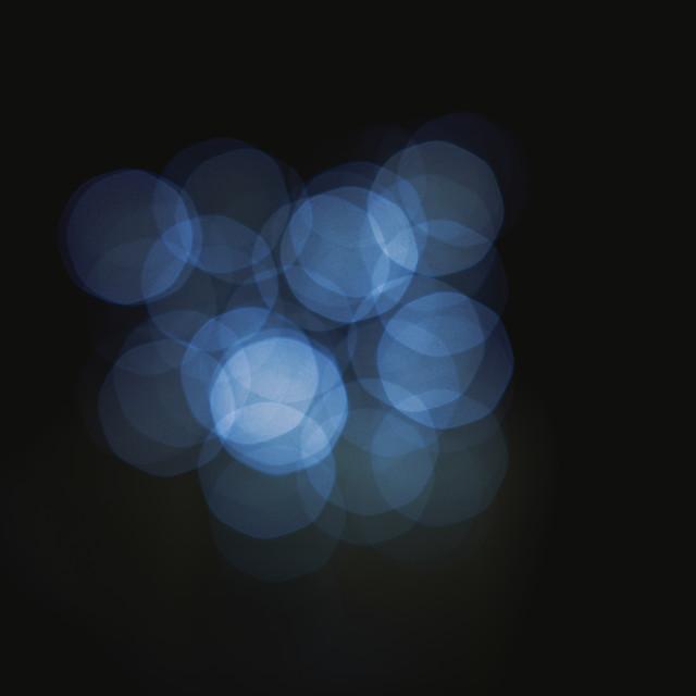 """Dark blue bokeh abstract light background defocused"" stock image"