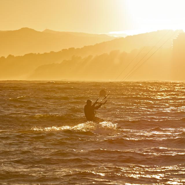 """Kite surfer in a sunset light"" stock image"