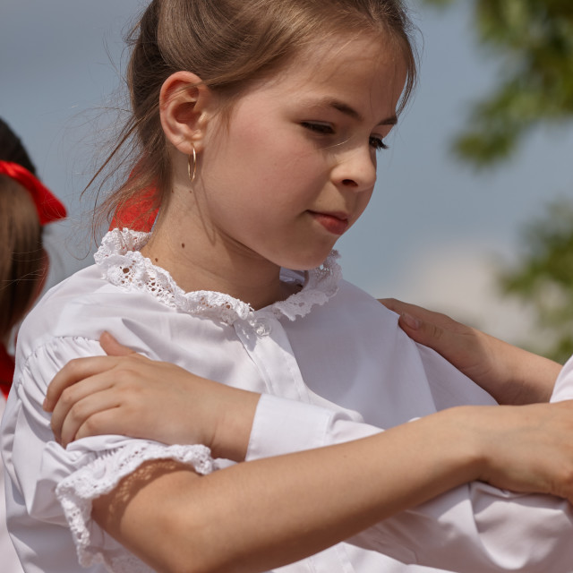 """Young girl dancing in a festival in traditional Hungarian costume"" stock image"