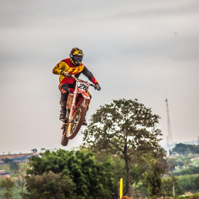 """Pilot jumping in motocross race event"" stock image"