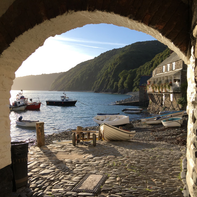 """Early morning in Clovelly harbour, Devon, England"" stock image"