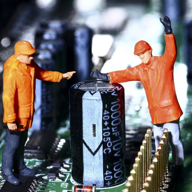 """""""Conceptual diorama image of miniature figure workmen"""" stock image"""