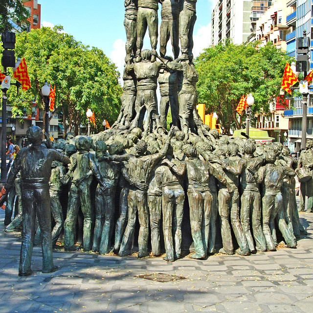 """Children looking at the Tarragona Human Tower Statue, Catalonia, Tarragona Province, Spain."" stock image"