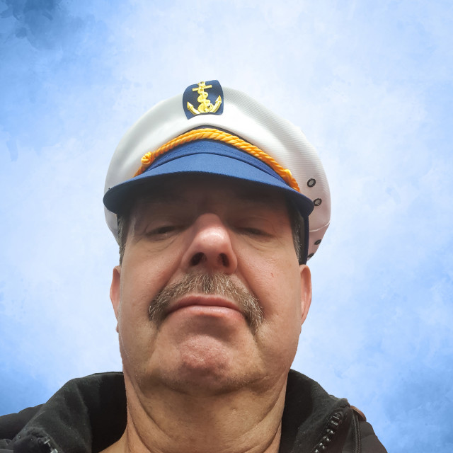 """Captain in front of blue sky"" stock image"