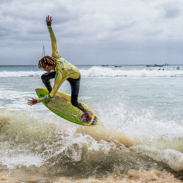 """Surfer catching a wave"" stock image"