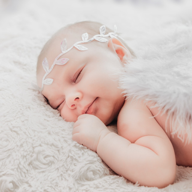 """""""close up on newborn baby girl, angel wings"""" stock image"""