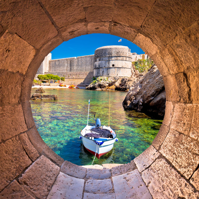 """""""Dubrovnik small harbor under city walls view through stone carved window"""" stock image"""