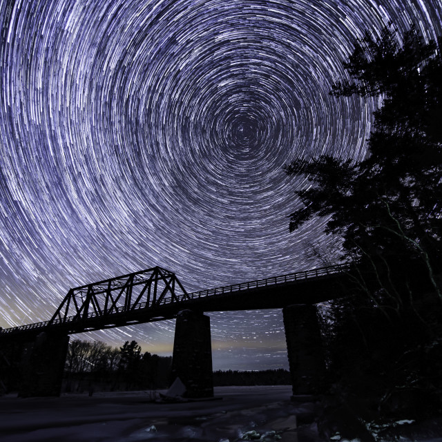 """Star trails under Wallace Swing Bridge"" stock image"