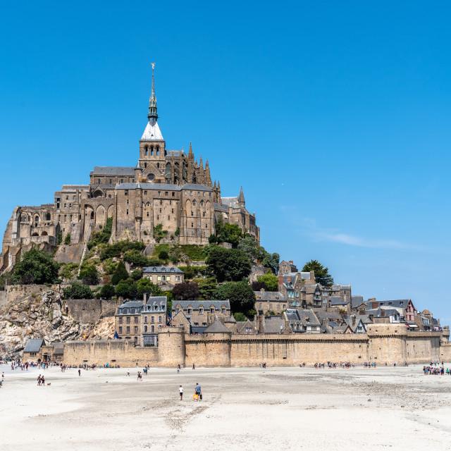 """View of Mont Saint Michel against sky"" stock image"