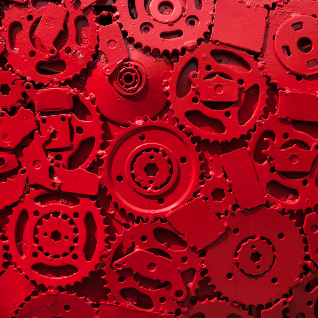 """Red metal gears textured background"" stock image"