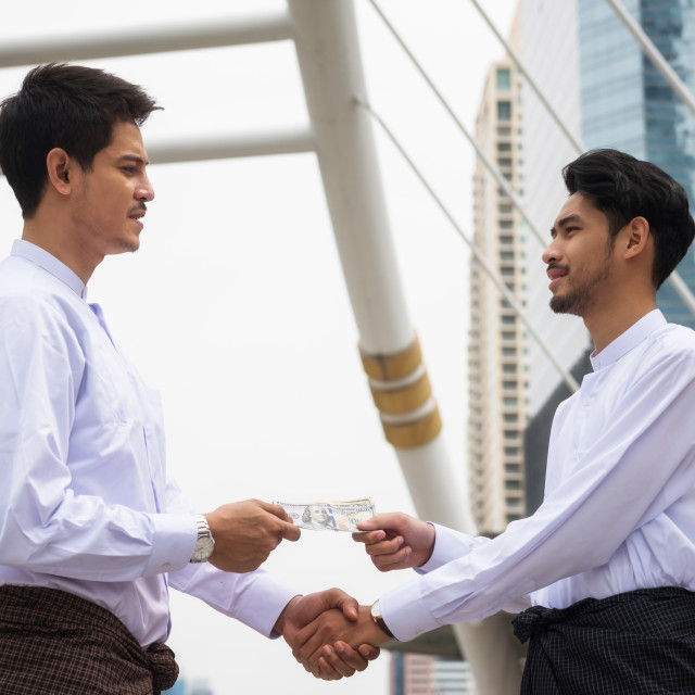"""Burmese businessmen agree project in city"" stock image"