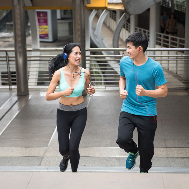 """Happy Asian couple run in town"" stock image"