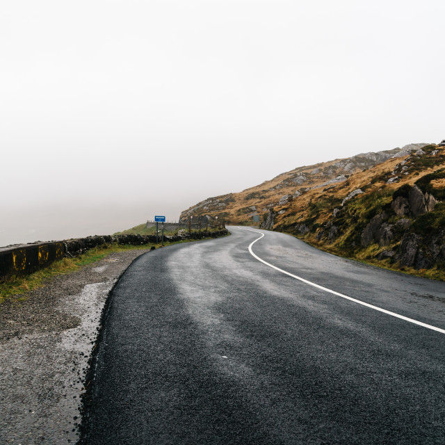 """Misty Lonely Road in Ireland"" stock image"