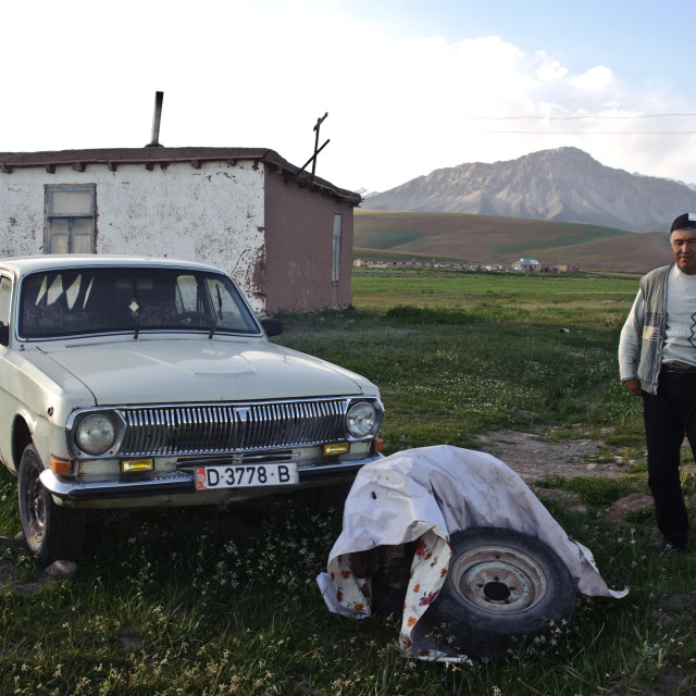 """Old Volga car and the owner ( Kyrgyzstan)"" stock image"