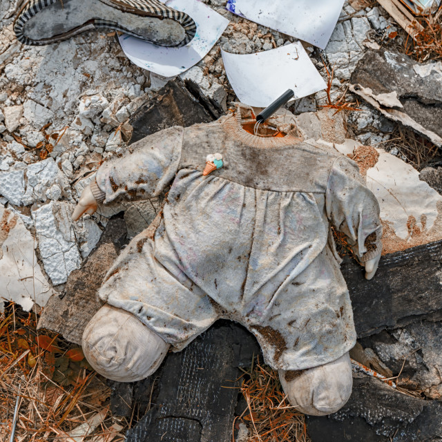 """""""Body of a headless doll in a distressing environment."""" stock image"""