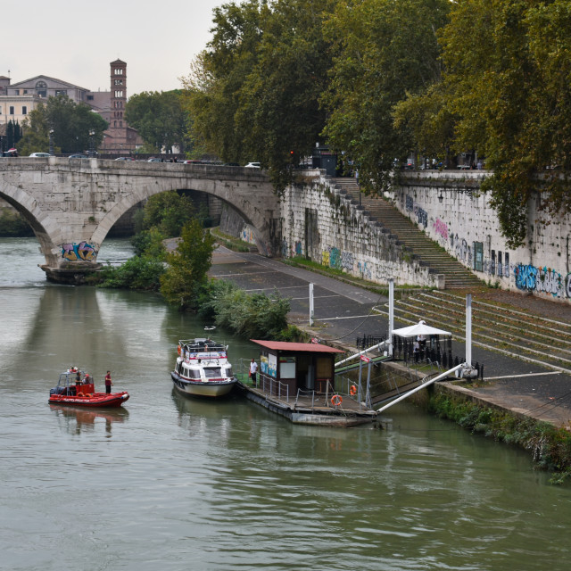 """Boats on Rome's Tiber"" stock image"