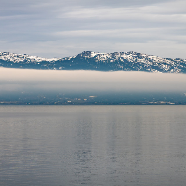 """Cloud around a Norwegian Mountain"" stock image"