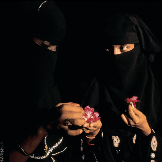 """Muslim women sharing roses ( India)"" stock image"