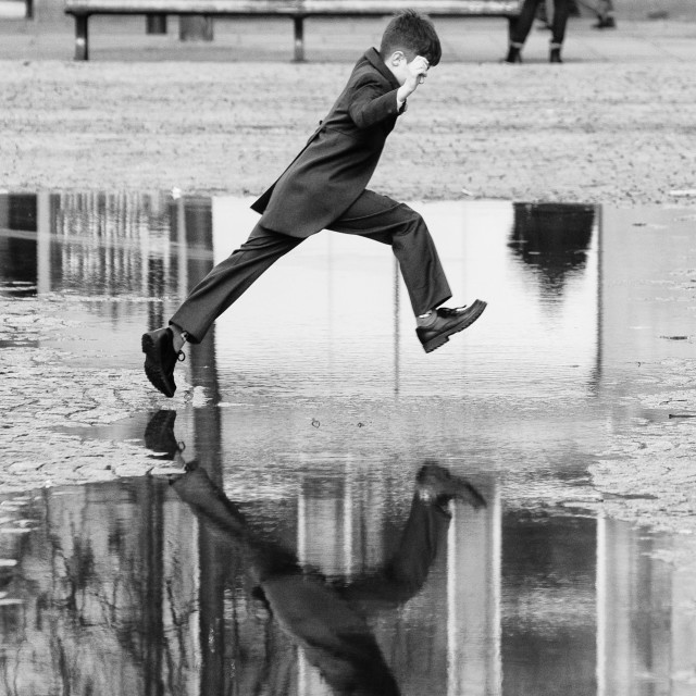 """Boy Jumping a Puddle"" stock image"