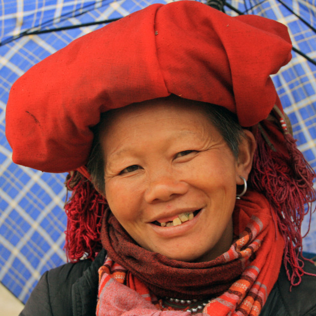 """Happy Vietnamese peasant woman with red hat"" stock image"