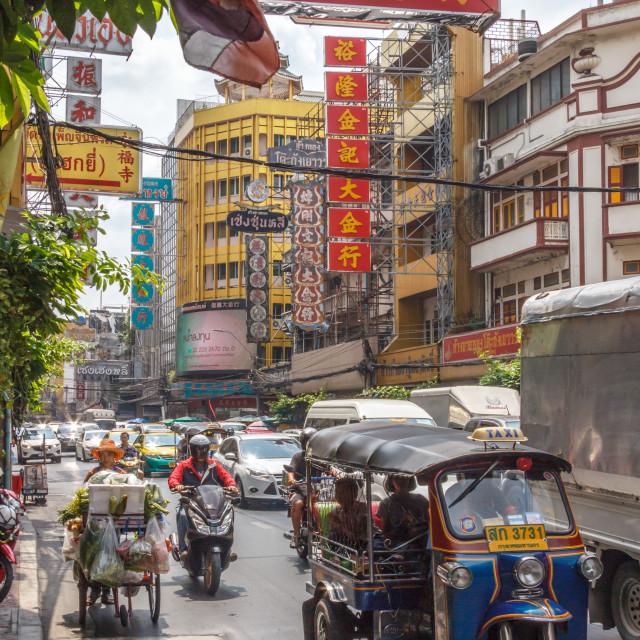 """Tuk tuk amongst heavy traffic"" stock image"