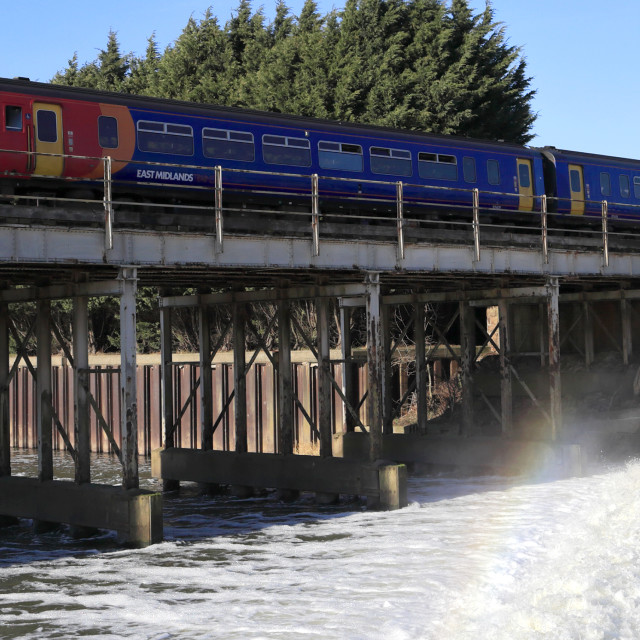 """153 class East Midlands train crossing over the river Trent, Newark on Trent,..."" stock image"