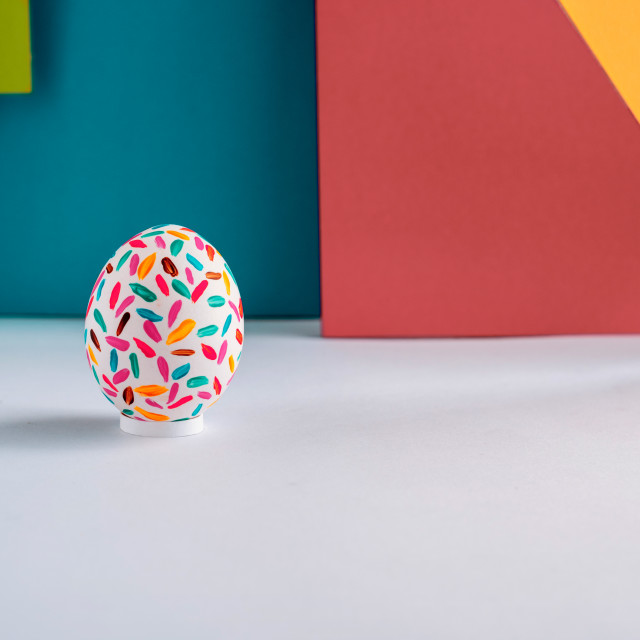 """""""Funny multicolored easter eggs on modern colored geometric background"""" stock image"""