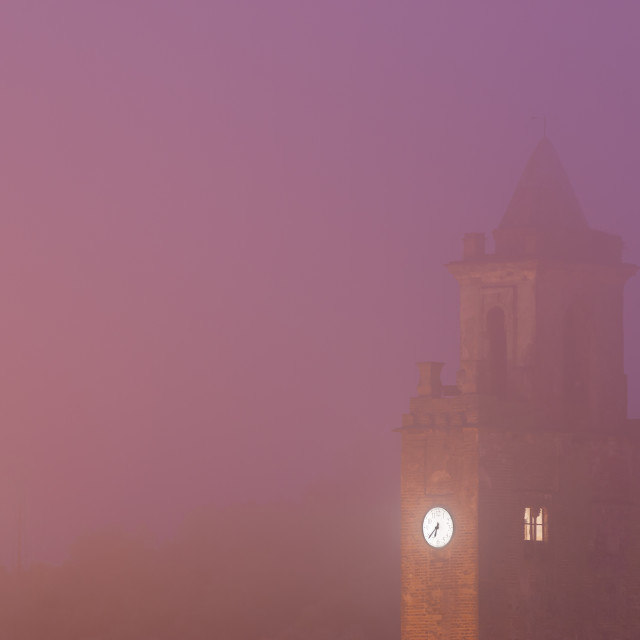 """""""Stone bell tower of church in mist"""" stock image"""