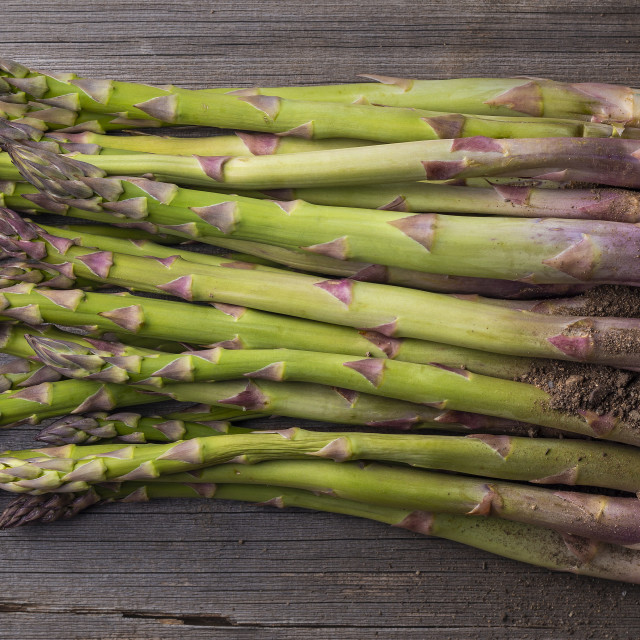 """""""Fresh raw asparagus from above on wooden table"""" stock image"""