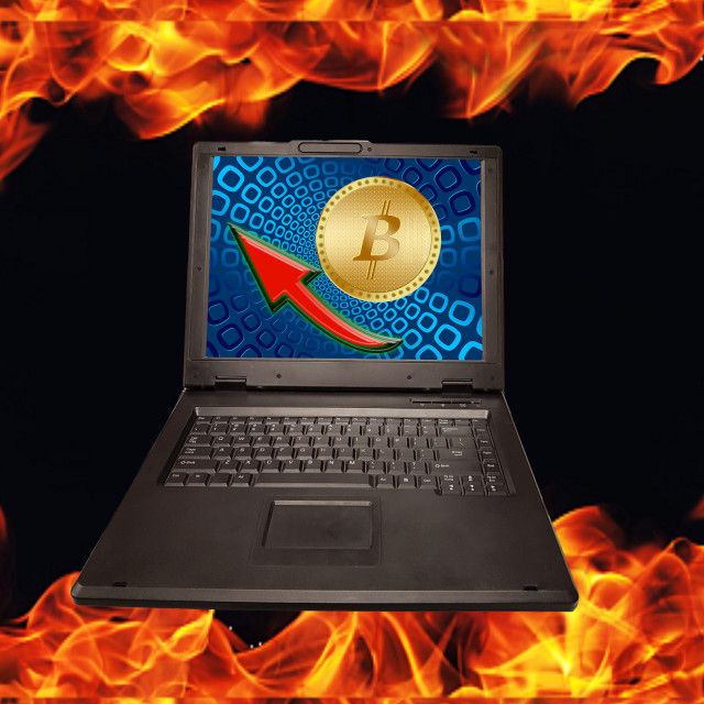 """Golden Bitcoin on PC Monitor."" stock image"