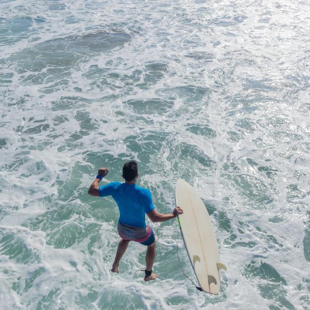 """Surfer Pier Jump Ocean"" stock image"