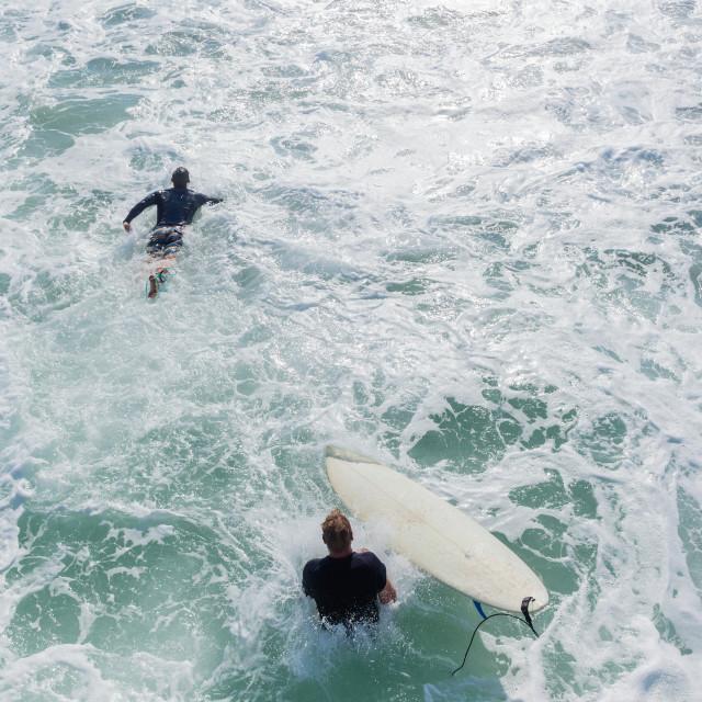 """Surfers Pier Jump Ocean"" stock image"