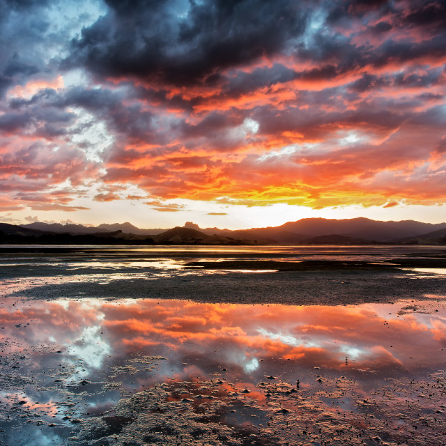 """Sunset at Matarangi"" stock image"